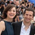 Marion Cotillard et Guillaume Canet lors du photocall du film Blood Ties au Festival de Cannes le 20 mai 2013
