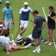 Andy Murray et Amélie Mauresmo à l'entraînement au All England Lawn Tennis and Croquet Club de Wimbledon à Londres, le 28 juin 2015