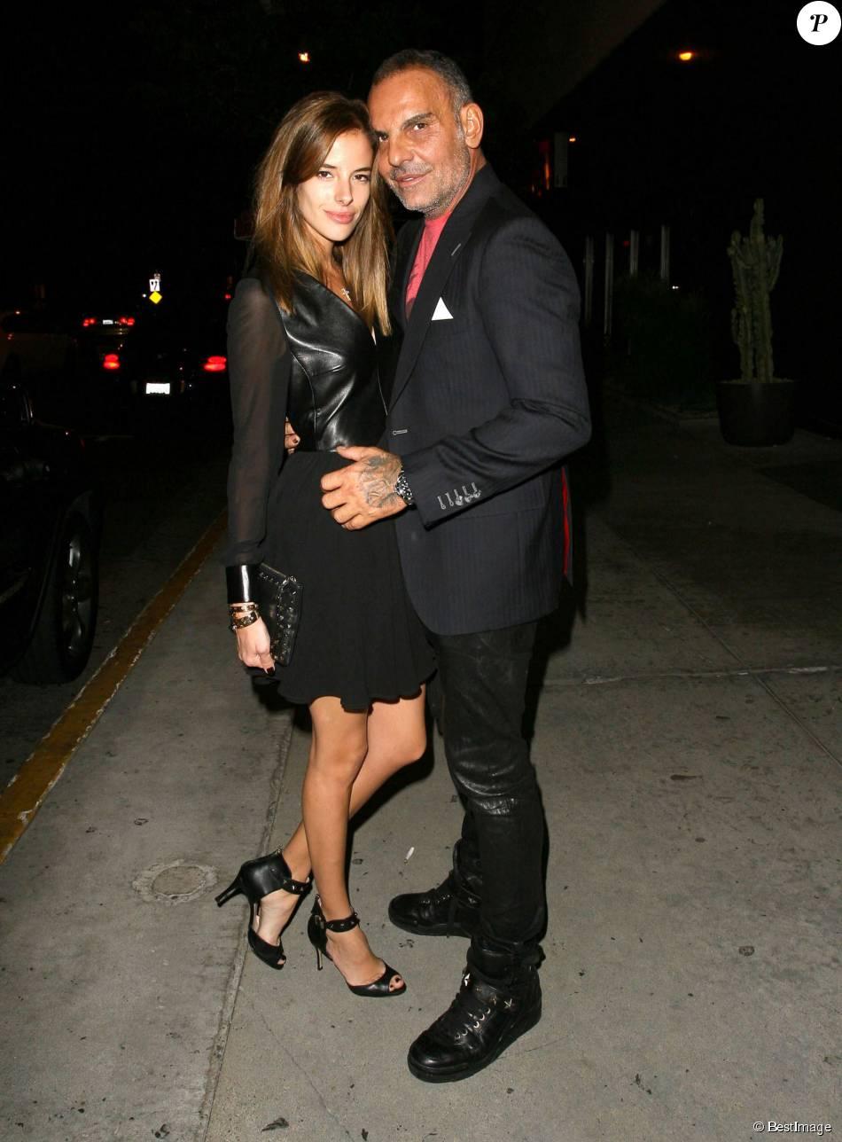 """Christian Audigier et son épouse Nathalie Sorensen devant la boite de nuit """"Bootsy Bellows"""" à West Hollywood, le 6 octobre 2013"""