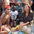 """- Exclusif - La premiere Dame de France, Valerie Trierweiler, accompagne pres de 5000 enfants parisiens a Cabourg (au depart de Clichy-la-garenne), dans le cadre de """"La journee des oublies des vacances"""", organisee par le Secours Populaire. Le 28 aout 2013"""