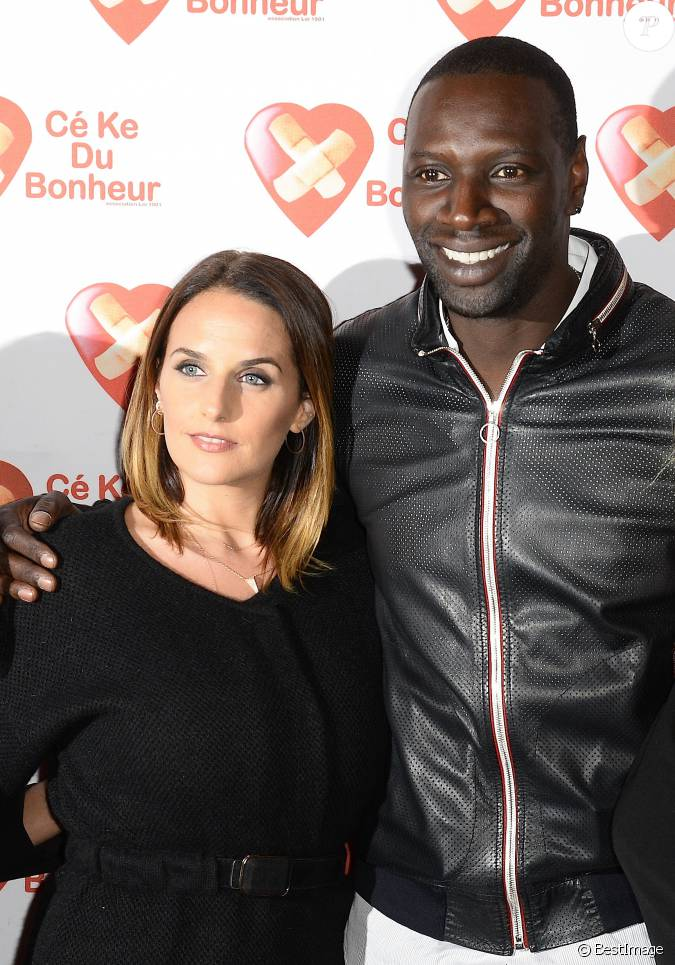 omar sy et sa femme h l ne avant premi re du film samba au gaumont champs elys es marignan. Black Bedroom Furniture Sets. Home Design Ideas
