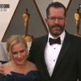 Patricia Arquette et son bien-aimé - Tapis rouge de la cérémonie des Oscars à Los Angeles le 28 février 2016.