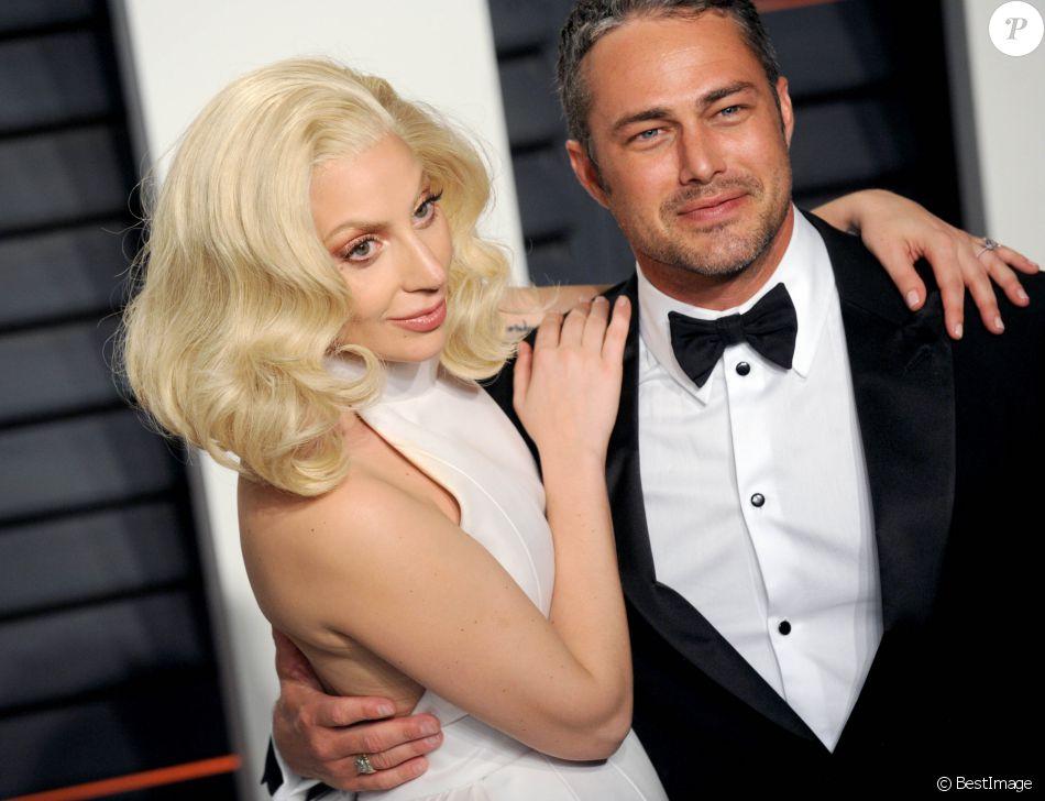 """La chanteuse Lady Gaga et son compagnon Taylor Kinney - People à la soirée """"Vanity Fair Oscar Party"""" après la 88e cérémonie des Oscars à Hollywood, le 28 février 2016."""