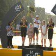 André Greipel, entouré de ses filles, fête sa victoire dans l'étape des Champs-Elysées, au dernier jour du Tour de France, à Paris le 24 juillet 2016. © Coadic Guirec / Bestimage