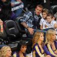 David Beckham, ses enfants et la mystérieuse brune le week-end dernier...