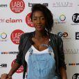 """Hapsatou Sy (enceinte) - Photocall """" 10 ans Labo International - Afro Fashion Remix """" à Paris Salon multi-ethnique""""LE LABO INTERNATIONAL"""" qui a eu lieu le 11 et 12 juin à l'espace des Blancs Manteaux dans le Marais. Des défilés, des shows, de nombreux happenings, des conférences ont rythmés le week-end sous le signe de la Mode et du Glamour"""