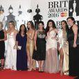 Perrie Edwards, Jade Thirlwall, Jesy Nelson et Leigh-Anne Pinnock du groupe Little Mix avec leurs mères Photocall à la Cérémonie des BRIT Awards 2016 à l'O2 Arena à Londres, le 24 février 2016.