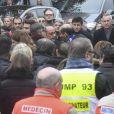 Didier Paillard, maire de Saint-Denis, François Hollande, président de la République, François Molins, procureur de la République de Paris lors de l'hommage aux victimes des attentats du 13 novembre 2015 devant le Stade de France à Saint-Denis, le 13 novembre 2016.