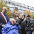 Didier Paillard, maire de Saint-Denis lors de l'hommage aux victimes des attentats du 13 novembre 2015 devant le Stade de France à Saint-Denis, le 13 novembre 2016.