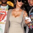 Kim Kardashian et son mari Kanye West arrivent à l'aéroport de Roissy-Charles-de-Gaulle, le 13 juin 2016.