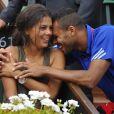 """""""Jo-Wilfried Tsonga and sa compagne Noura El Swekh le 14 septembre 2014 lors de la demi-finale de Coupe Davis entre la France et la République tchèque à Roland-Garros. Le couple attend son premier enfant pour 2017."""""""