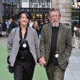 John Hurt et sa femme Anwen Rees-Myers au vernissage de l'exposition d'été de la Royal Academy of Arts à Londres le 4 juin 2014. L'acteur britannique, fameux pour ses rôles dans Midnight Express, Alien, Elephant Man ou encore Harry Potter, est mort le 25 janvier 2017 à son domicile dans le Norfolk, des suites d'un cancer du pancréas.