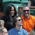 Amel Bent et Patrick Antonelli - Internationaux de France de tennis de Roland Garros à Paris, le 5 juin 2014.
