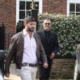 George Michael quitte son domicile avec Fadi Fawaz, le 14 mars 2012 à Londres