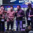 Bernard Montiel et Yoann, Florentin (Flo) et Jérôme du groupe Arcadian lors du concert MFM Radio Live, place de la République à Lyon, le 3 mars 2017.