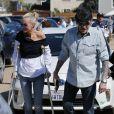 """Johnny Hallyday avec sa femme Laeticia, qui marche toujours avec des béquilles, accompagnés de Maxim Nucci (Yodelice), arrivent au restaurant """"Soho House"""" à Malibu, le 09 mars 2017."""
