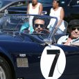 """Johnny Hallyday accompagné de Maxim Nucci (Yodelice), arrive au restaurant """"Soho House"""" à Malibu, au volant de son cabriolet AC Cobra marqué de son chiffre porte-bonheur, le numéro 7. Laeticia Hallyday, toujours en béquilles, les rejoint dans une autre voiture. Malibu, le 09 mars 2017."""