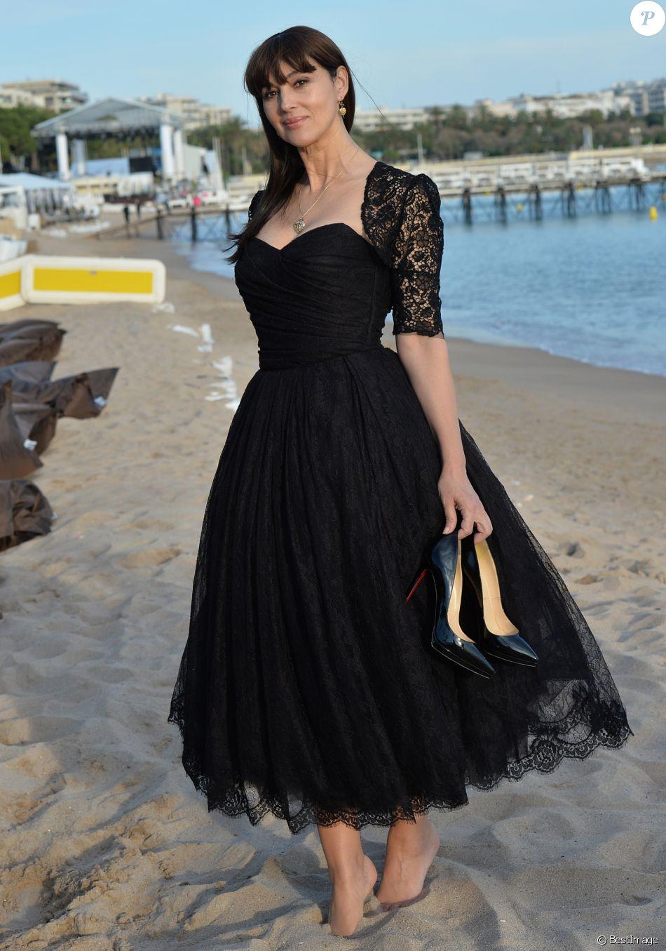 Exclusif - Prix spécial - Rencontre avec Monica Bellucci sur la plage Magnum à l'occasion du 67ème festival de Cannes à à Cannes le 18 mai 2014.