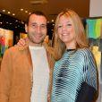 """Zinedine Soualem et sa compagne Caroline Faindt lors de la soirée des """"Femmes de talent"""" à la boutique Apostrophe à Paris, France, le 21 mars 2017."""