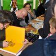Riss (Laurent Sourisseau) - Fête de l'Humanité 2015 dans le Parc de la Courneuve à Paris et hommage aux dessinateurs de Charlie Hebdo, le 13 septembre 2015.