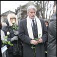 Alain Delon et Mireille Darc aux obsèques de Georges Cravenne