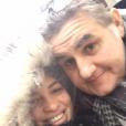 Pierre Ménès pose avec sa compagne Mélissa sur Facebook en janvier 2016.