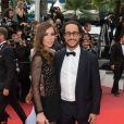 Emilie Broussouloux et Thomas Hollande montent les marches lors de la projection du film 'L'Amant Double' au Palais Des Festivals à Cannes, le 26 mai 2017