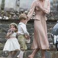 Kate Middleton, duchesse de Cambridge, et sa fille la princesse Charlotte de Cambridge - Mariage de Pippa Middleton et James Matthew, en l'église St Mark Englefield, Berkshire, Royaume Uni, le 20 mai 2017.