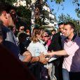 Le président de la République française Emmanuel Macron et sa femme, la première dame Brigitte (Trogneux) saluent la foule devant leur domicile avant de faire une balade à vélo en bord de mer au Touquet, France, le 17 juin 2017. © Sébastien Valiela-Dominique Jacovides/Bestimage