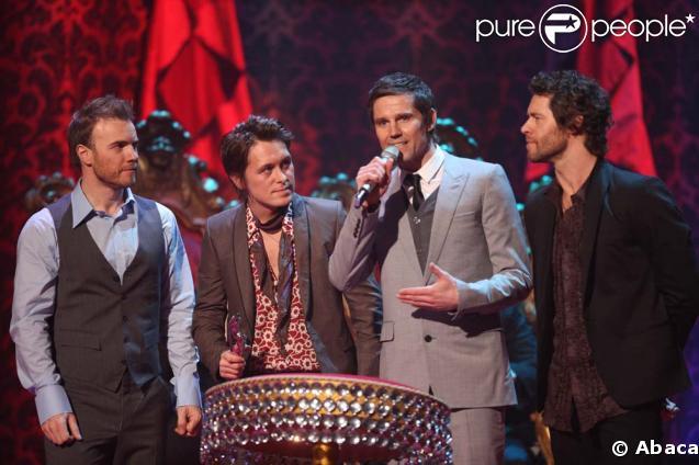 Les Take That : Gary Barlow, Mark Owen, Jason Orange, Howard Donald