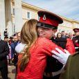 Le prince héritier Hussein de Jordanie, ici étreint par sa mère la reine Rania, est sorti de l'Académie militaire royale de Sandhurst, à Camberley dans le Berkshire, le 11 août 2011. Ses parents le roi Abdullah II de Jordanie, qui représentait la reine Elizabeth II pour la parade de sortie, sa mère la reine Rania, ses soeurs les princesses Iman et Salma ainsi que son frère le prince Hashem étaient tous présents.