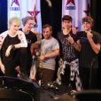 """Michael Clifford (guitare, choeur), Luke Hemmings (chanteur principal, guitare), Calum Hood (basse, chant), Ashton Irwin (batterie, choeur) - Le groupe pop rock australien """"5 Seconds Of Summer"""" chez Virgin Radio à Paris, le 26 juin 2014."""