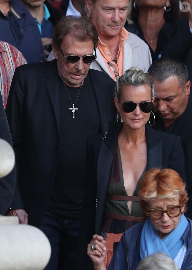 Johnny et Laeticia Hallyday - Sorties des obsèques de Mireille Darc en l'église Saint-Sulpice à Paris. Le 1er septembre 2017.