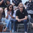 Le prince Harry et sa compagne Meghan Markle lors de leur première apparition officielle lors de la finale de tennis en chaise roulante pendant les Invictus Games 2017 à Toronto, le 25 septembre 2017.