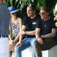 """""""Johnny Hallyday et sa femme Laeticia quittent leur hôtel en compagnie de Sébastien Farran et du père de Laeticia, André Boudou à Miami, le 12 mai 2014."""""""