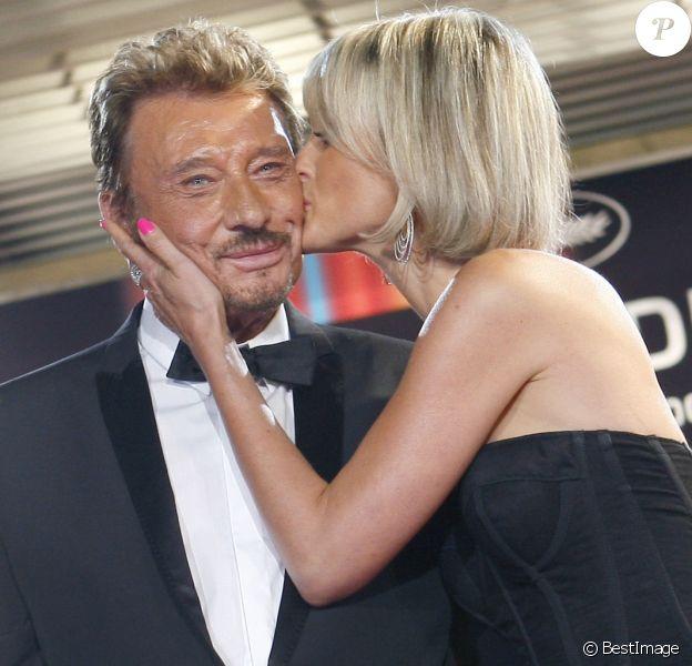"""Johnny et Laeticia Hallyday - Montée des marches du film """"Vengeance"""" au 62e festival de Cannes, le 17 mai 2009."""