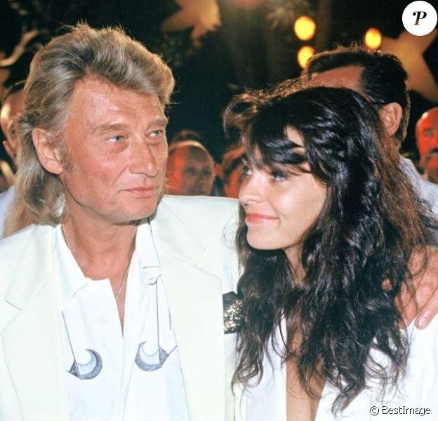 Johnny Hallyday et Adeline Blondieau à Saint-Tropez, le 27 juillet 1991.