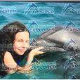 La fille d'Axelle Laffont nage avec un dauphin - Instagram, 4 janvier 2018