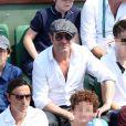 Jean Dujardin et ses fils Jules et Simon à la finale homme de Roland-Garros 2014, le dimanche 8 juin 2014