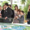 Le roi Mohammed VI du Maroc, la princesse Lalla Salma et le prince héritier Moulay El Hassan lors de la visite officielle de François Hollande et Valérie Trierweiler au Maroc, à Casablanca en avril 2013.