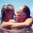 Johnny et Laeticia Hallyday immortalisés par leur ami Pierre Rambaldi dans leur piscine à Saint-Barthélemy, le 13 août 2017.