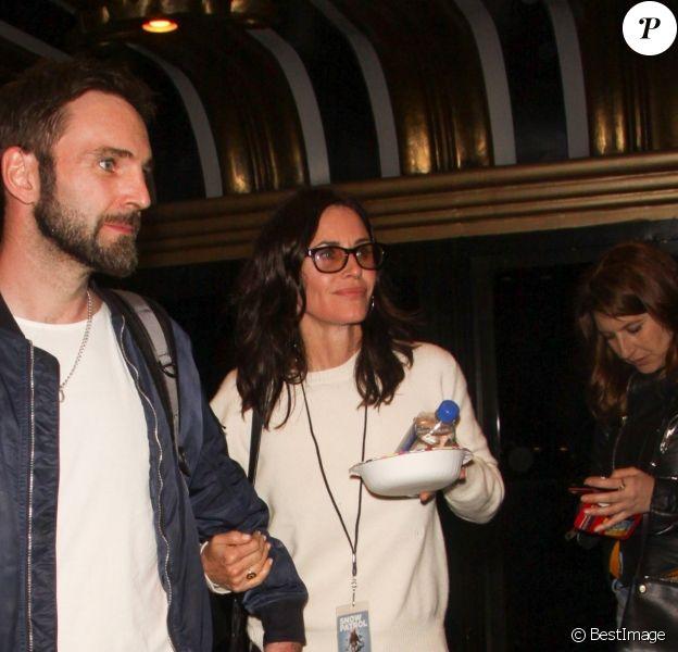 Exclusif - Courteney Cox et son compagnon Johnny McDaid sortent du concert de Snow Patrol à Los Angeles, le 25 avril 2018.
