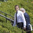 Le président de la République Française Emmanuel Macron avec sa femme la Première Dame Brigitte Macron, et ses équipes, aux abords du manoir Richelieu dans le cadre du sommet du G7 au manoir Richelieu. La Malbaie, le 8 juin 2018. © Ludovic Marin/Pool/Bestimage