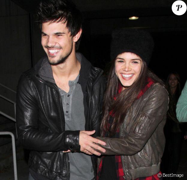Taylor Lautner et sa compagne Marie Avgeropoulos sont alles voir le concert de Jay-Z au Staples Center a LOs Angeles.