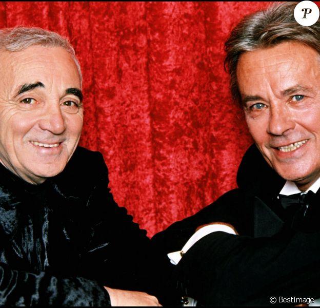 ARCHIVES - Charles Aznavour et Alain Delon en décembre 1997.