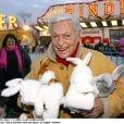 """Guy Lux - """"Pas d'enfants sans vacances"""" au cirque Pinder, le 11 décembre 2002."""
