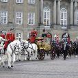 La reine Margrethe II de Danemark arrive dans son carrosse doré au palais de Christiansborg à Copenhague le 4 janvier 2019 pour la dernière des réceptions du Nouvel An.