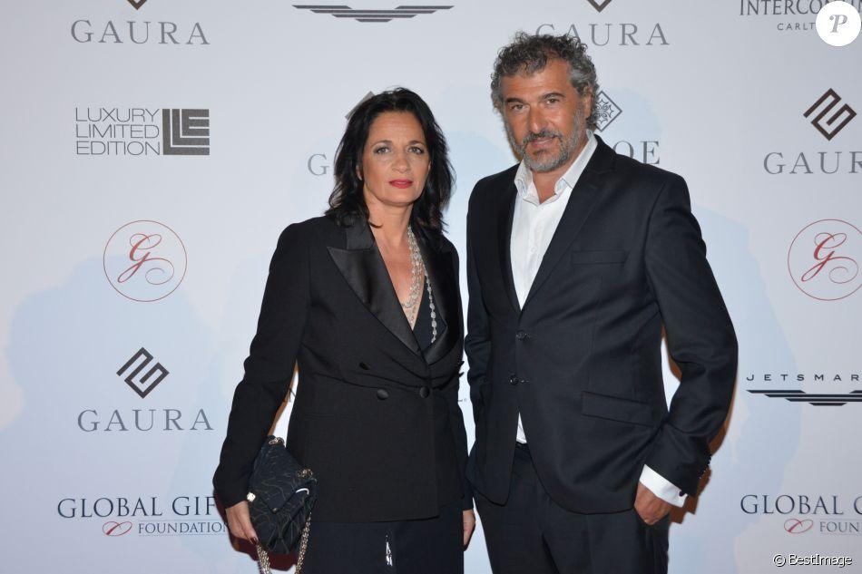 """Daniel Lévi et son épouse Sandrine Aboukrat au dîner caritatif """"The Global Gift Initiative"""" au Carlton Beach Club lors du 71e Festival International du Film de Cannes, le 11 mai 2018. © CVS/Bestimage"""