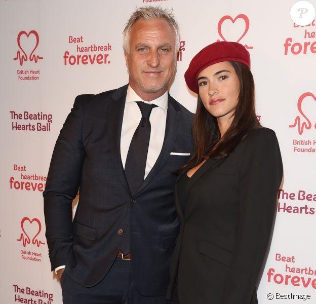 """David Ginola et sa compagne Maeva Denat arrivent à la soirée """"The Beating Hearts Ball"""" à Londres, le 27 février 2019."""