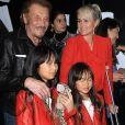Johnny Hallyday, sa femme Laeticia et leurs filles Jade et Joy au vernissage de l'exposition du photographe Mathieu Cesar à Los Angeles. Le 21 février 2017.